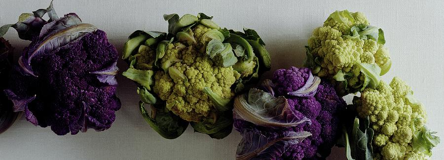 A Group Of Cauliflower Heads Photograph by Romulo Yanes