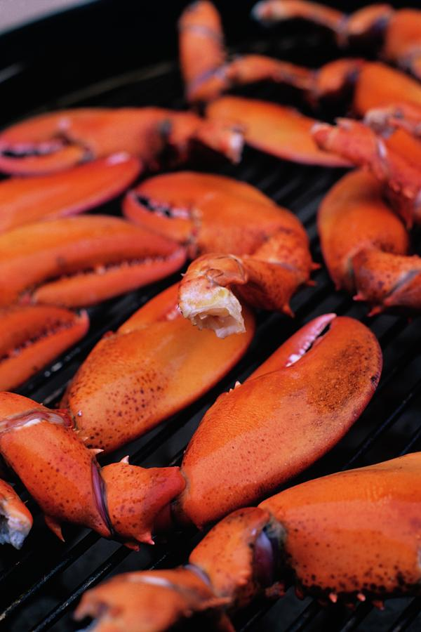 A Group Of Lobster Claws On A Grill Photograph by Romulo Yanes