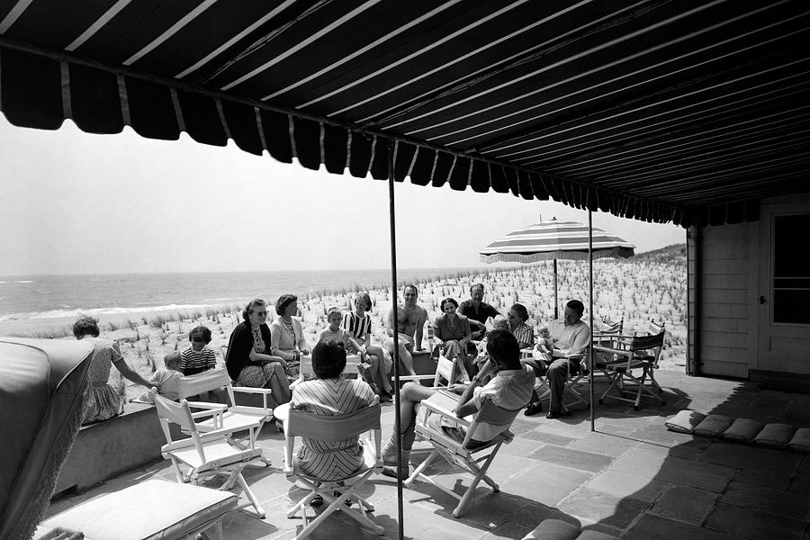 A Group Of People On A Terrace Overlooking Photograph by Tom Leonard
