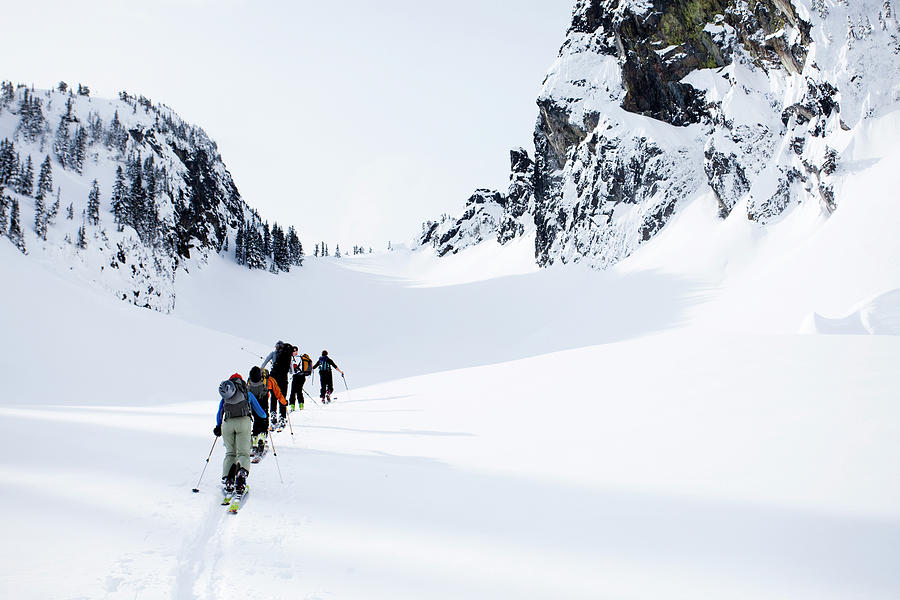 Adult Photograph - A Group Of Skiers In The Backcountry by Michael Hanson