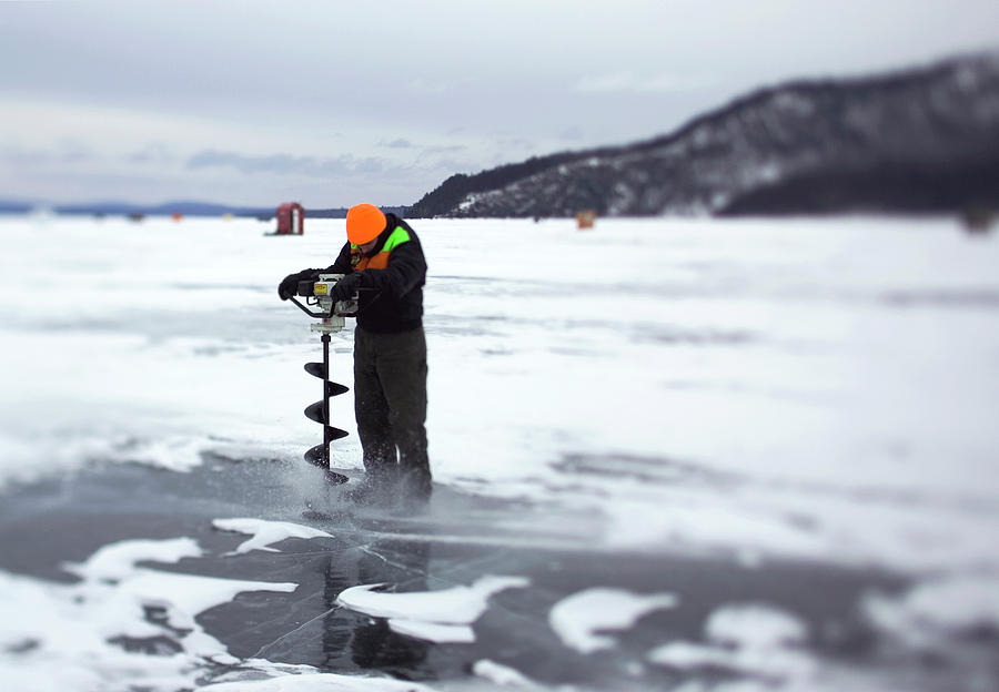 Auger Photograph - A Ice Fisherman Uses An Auger To Drill by David McLain