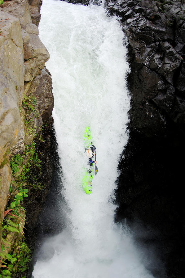 Action Photograph - A Kayaker Takes The Plunge On Huge by Lucas Gilman