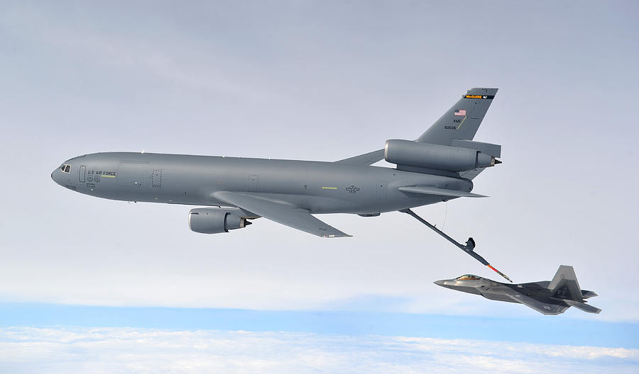 Eurofighter Photograph - A Kc-10 Extender Refuels An F-22 Raptor by Celestial Images