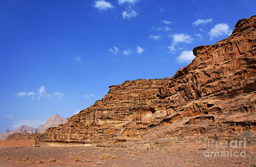 Wadi Rum Photograph - A Landscape Of Rocky Outcrops In The Desert Of Wadi Rum Jordan by Robert Preston