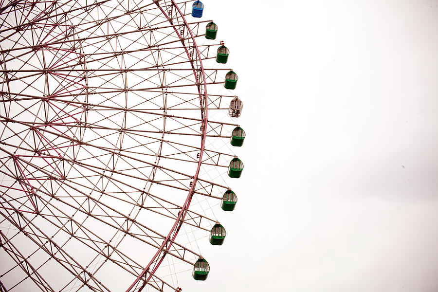 A Large Ferris Wheel On A Cloudy Day Photograph by Adam Hester