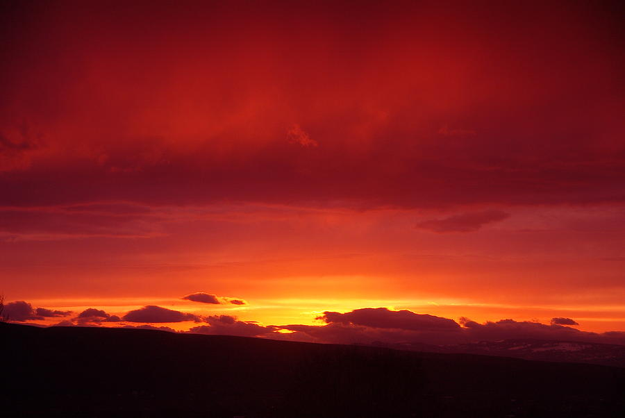 Sunset Photograph - A Light In The Clouds  by Jeff Swan