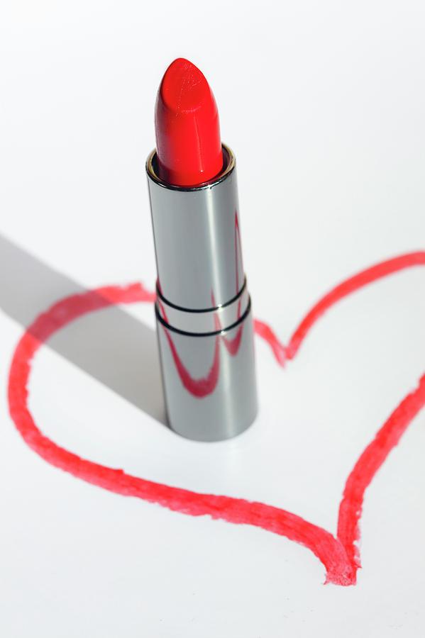 A Lip-stick In A Drawn Heart Shape On Photograph by Reggie Casagrande