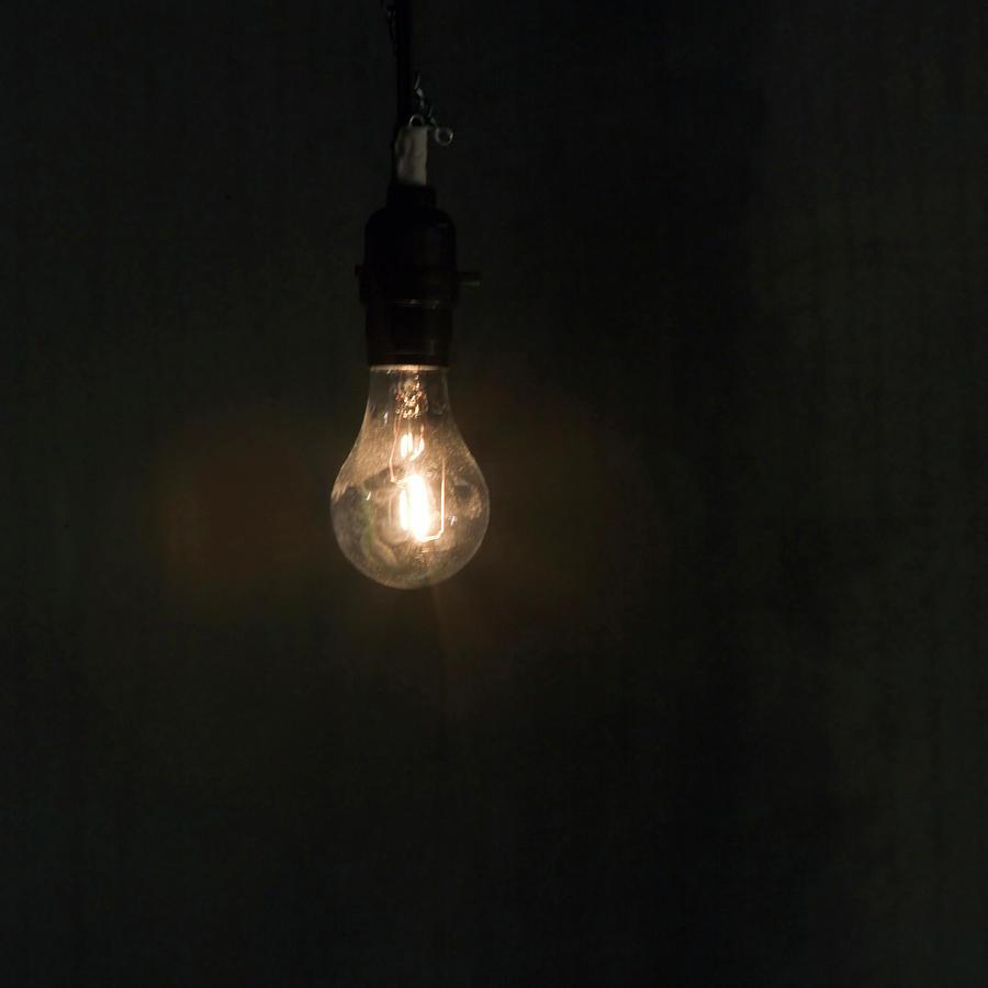 Hanging light bulbs Vintage Lit Bare Hanging Light Bulb Fine Art America Lit Bare Hanging Light Bulb Photograph By Ron Koeberer