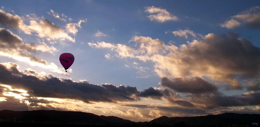 Hot Air Balloon Photograph - A Lone Flight by Glenn McCarthy Art and Photography