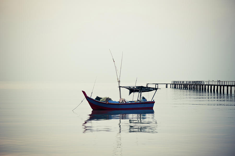 A Lonely Boat Photograph by Ivan Hor