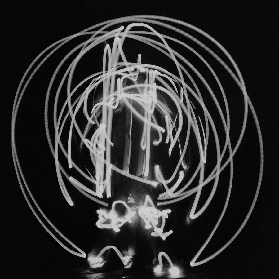 A Long Exposure Photograph Of A Man Dressing Photograph by Herbert Matter