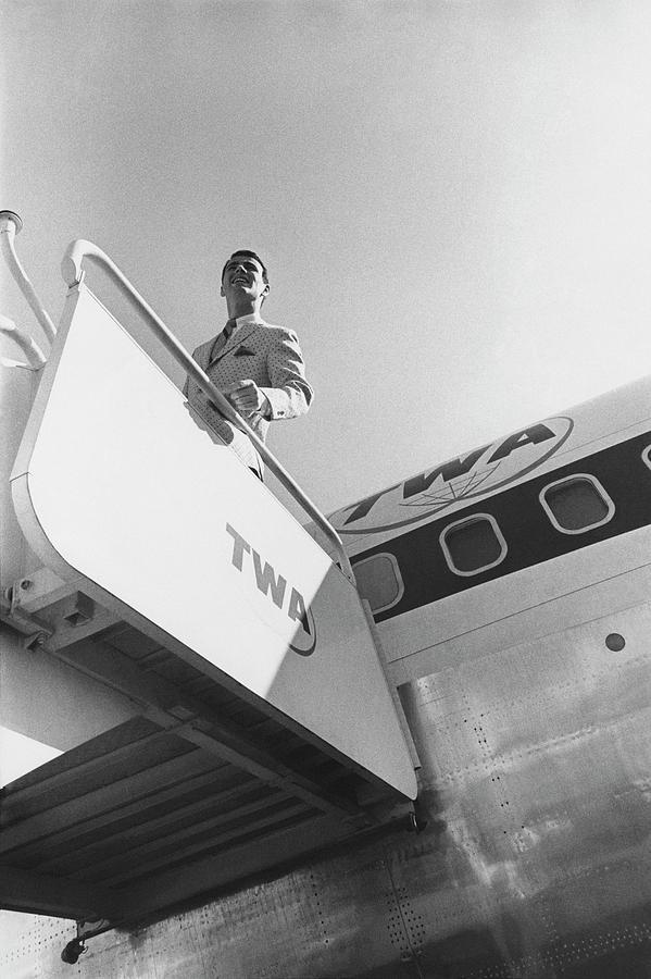 A Male Model Disembarking A Twa Boeing 707 Plane Photograph by Leonard Nones