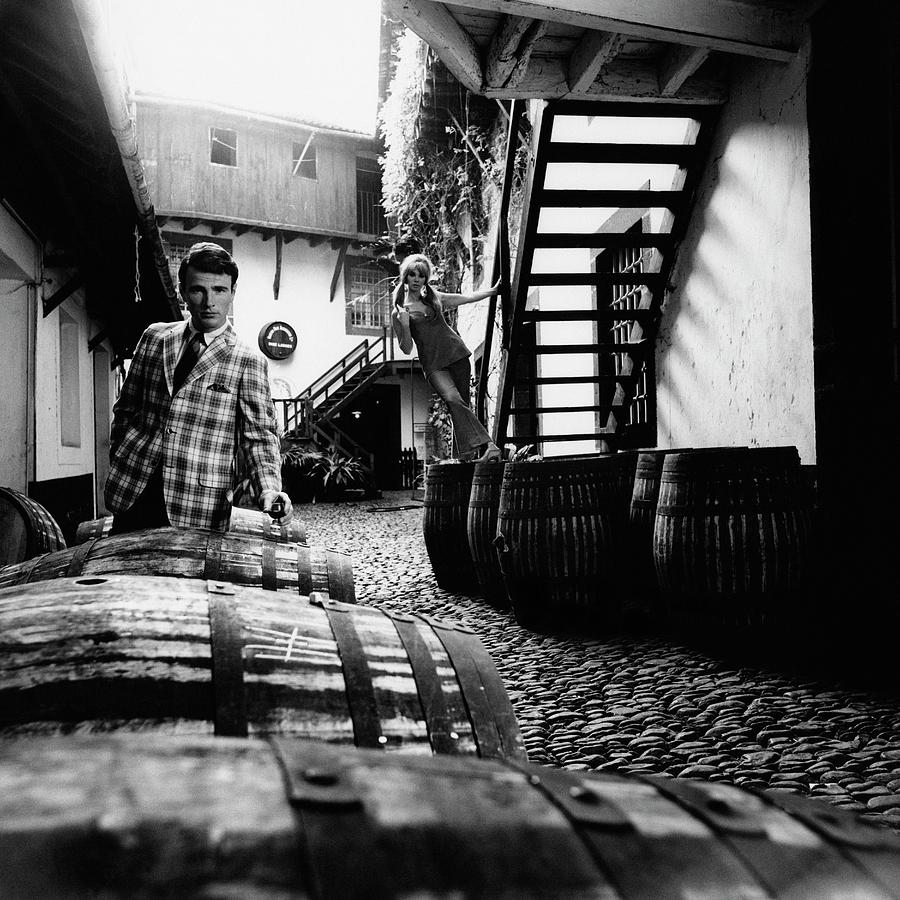 A Male Model Posing By Wine Barrels Photograph by Leonard Nones