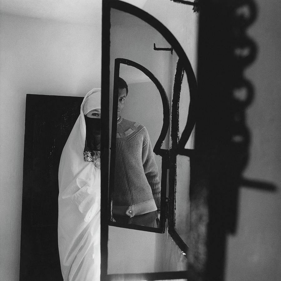 A Male Model Posing In A Mirror With A Woman Photograph by Chadwick Hall