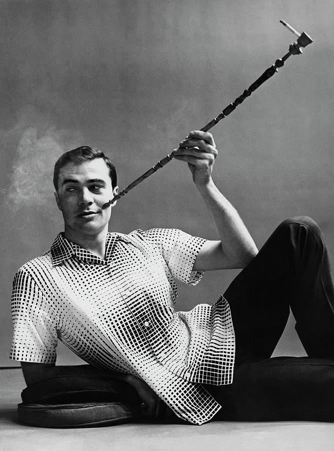 A Male Model Smoking A Cigarette From A Long Pipe Photograph by Emme Gene Hall