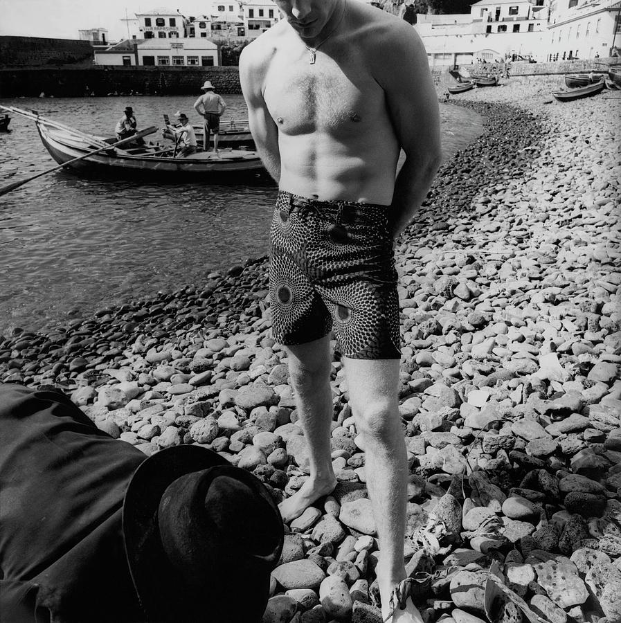 A Male Model Standing On A Stone Beach In Madeira Photograph by Leonard Nones