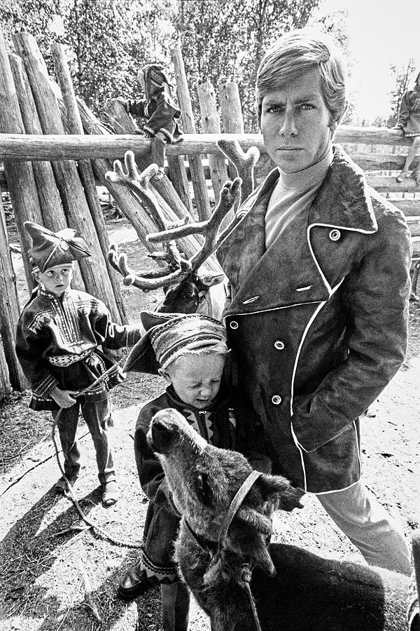 A Male Model Wearing A Coat Posing With Children Photograph by Leonard Nones