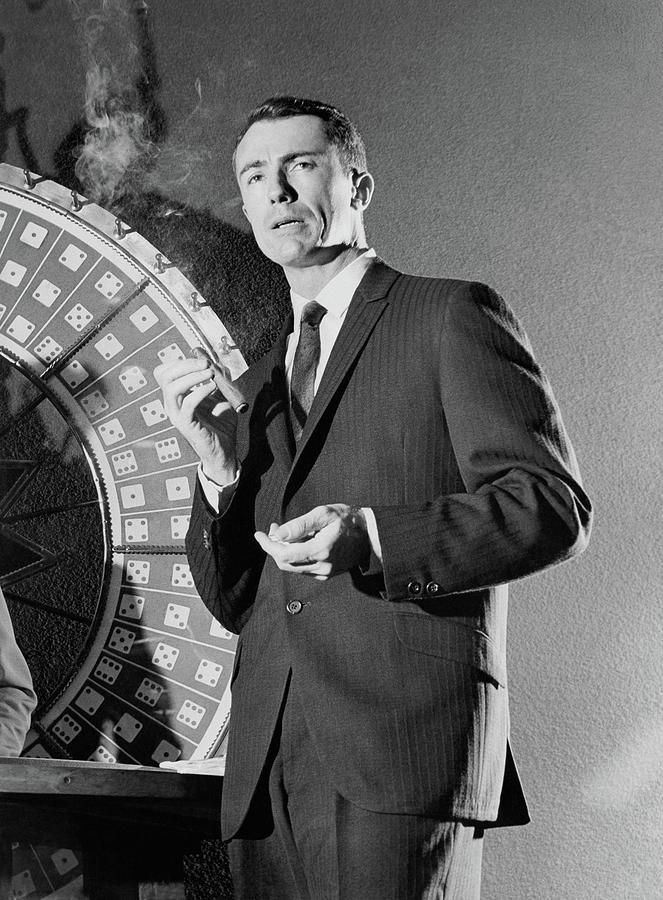 A Male Model Wearing A Dark Pinstriped Suit Photograph by Richard Waite