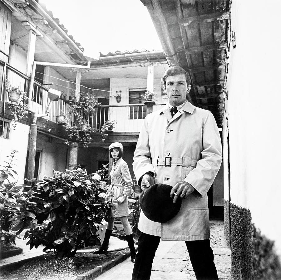 A Male Model Wearing A Trench Coat Photograph by Leonard Nones