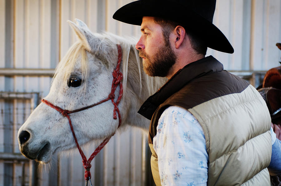 American Culture Photograph - A Male Ranch Hand In A Cowboy Hat by Kyle George
