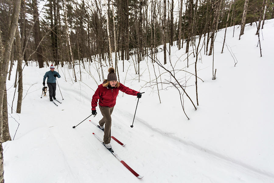 On The Move Photograph - A Man And Woman Cross Country Skiing by Jerry Monkman