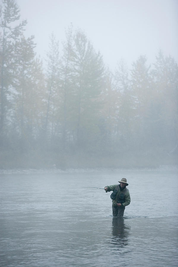 40's Photograph - A Man Fly-fishing On Elk River, Bc by Henry Georgi