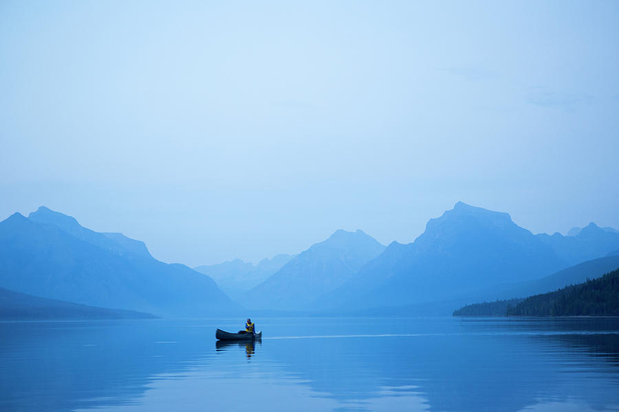 A Man In A Canoe Photograph by Jordan Siemens