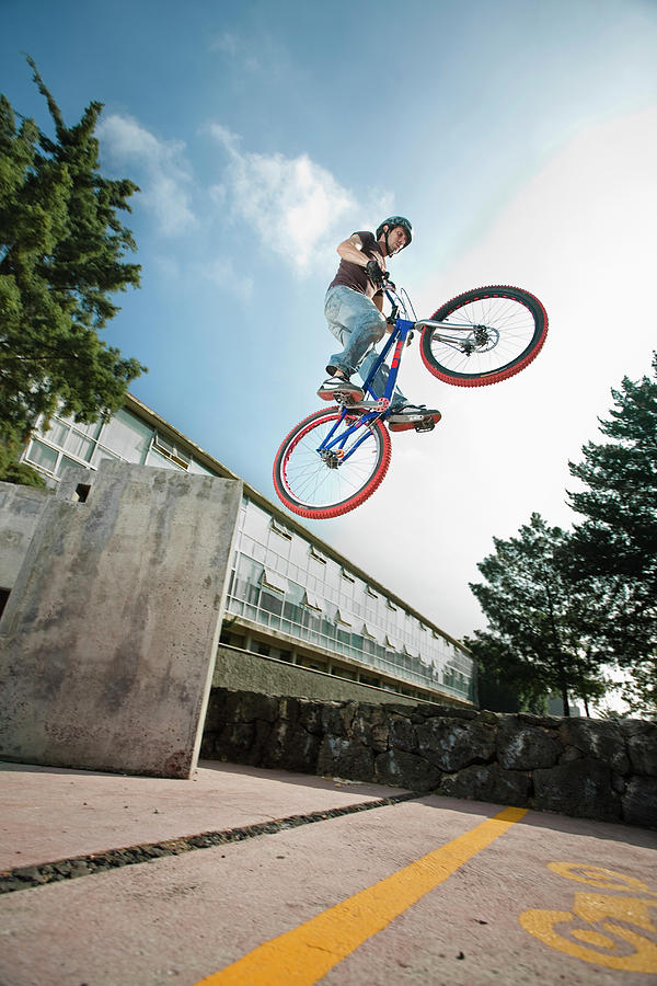 20s Photograph - A Man Jumps With His Bike In Mexico by Marcos Ferro