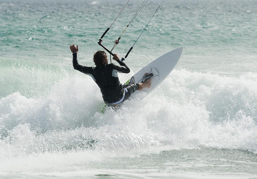 A Man Kitesurfing At Punta Paloma Beach Photograph