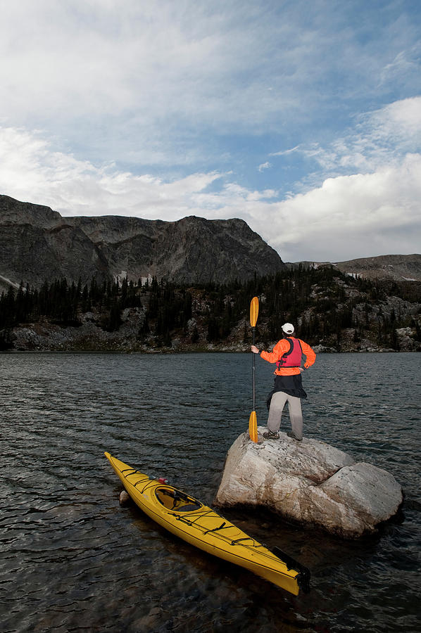 Adult Photograph - A Man Sea Kayaking On Lake Marie by Tom Bol