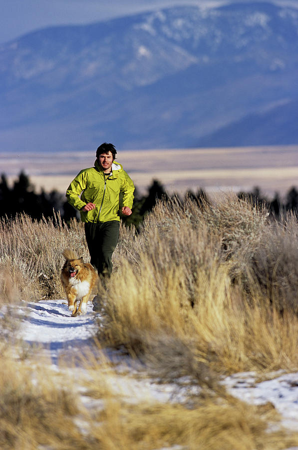 20s Photograph - A Man Trail Runs On A Winter Day by Bob Allen
