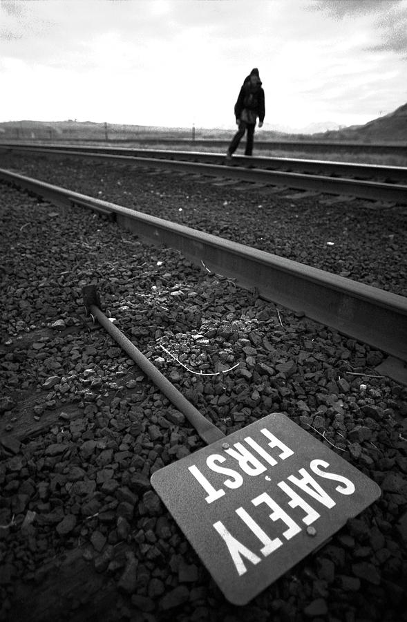 Journey Photograph - A Man Walking Down Railroad Tracks by Corey Rich