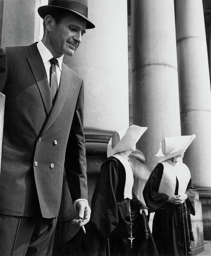 A Man Wearing A Suit And Two Nuns Photograph by Emme Gene Hall
