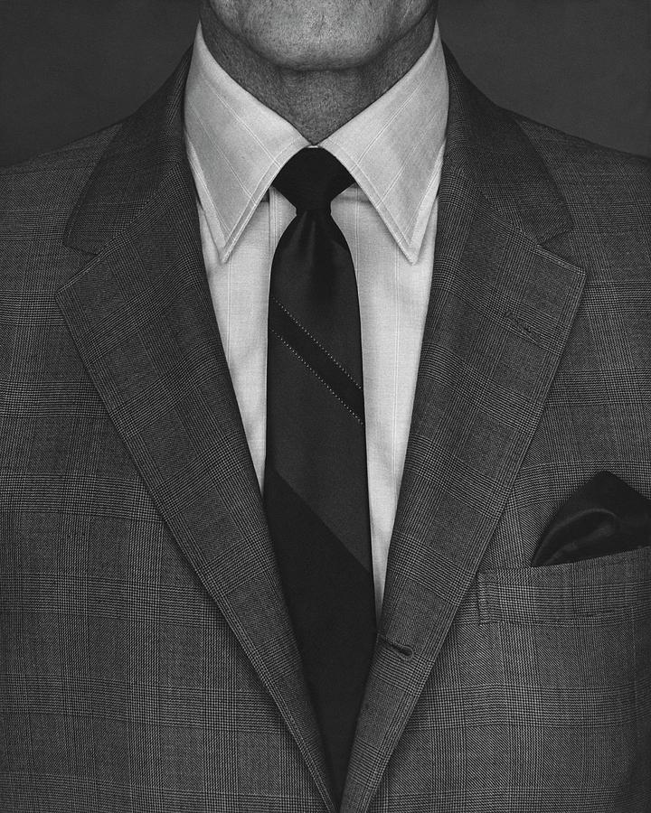 A Man Wearing A Suit Photograph by Peter Scolamiero