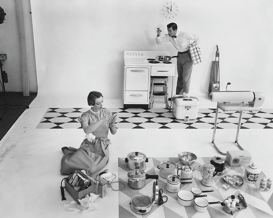 A Married Couple With Kitchen Appliances Photograph by Herbert Matter