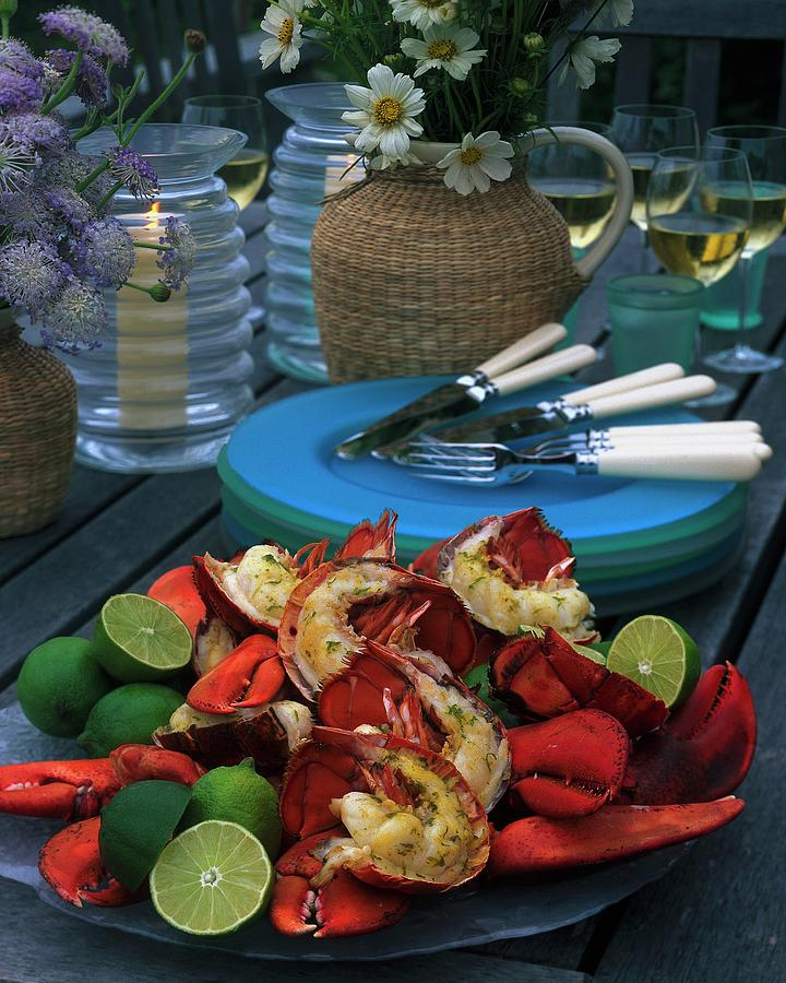 A Meal With Lobster And Limes Photograph by Romulo Yanes