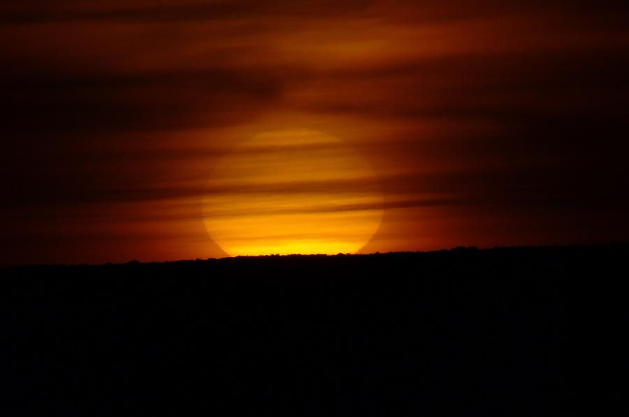 Sun Photograph - A Misted Sunset by Jeff Swan