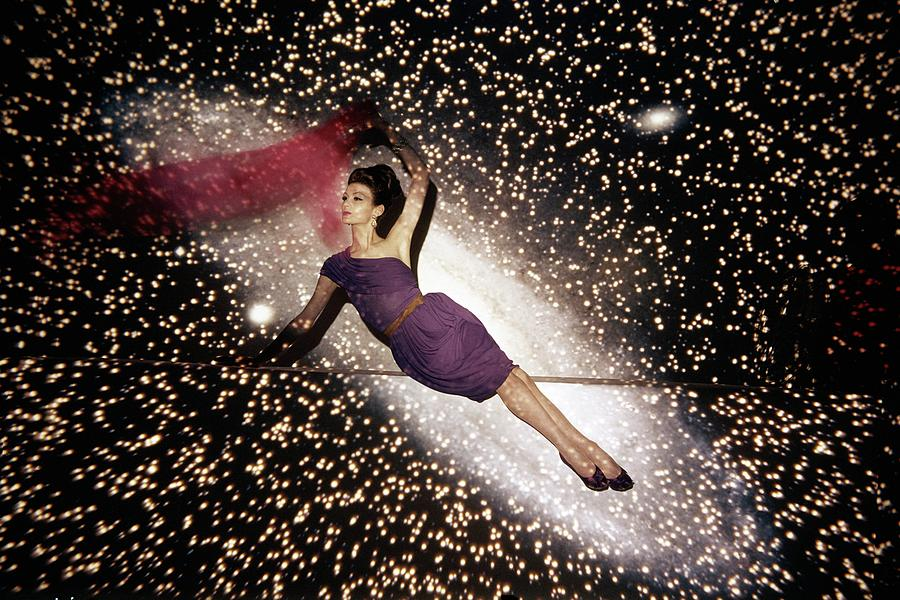 A Model Against A Galaxy Backdrop Photograph by John Rawlings