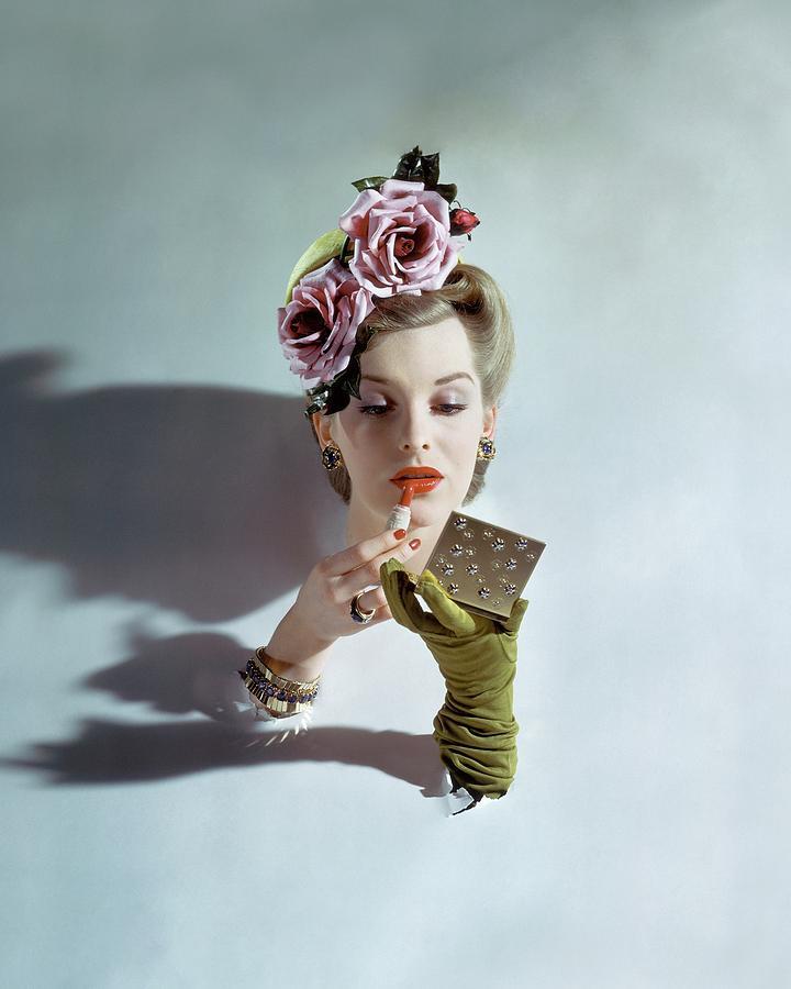 A Model Applying Lipstick Photograph by John Rawlings