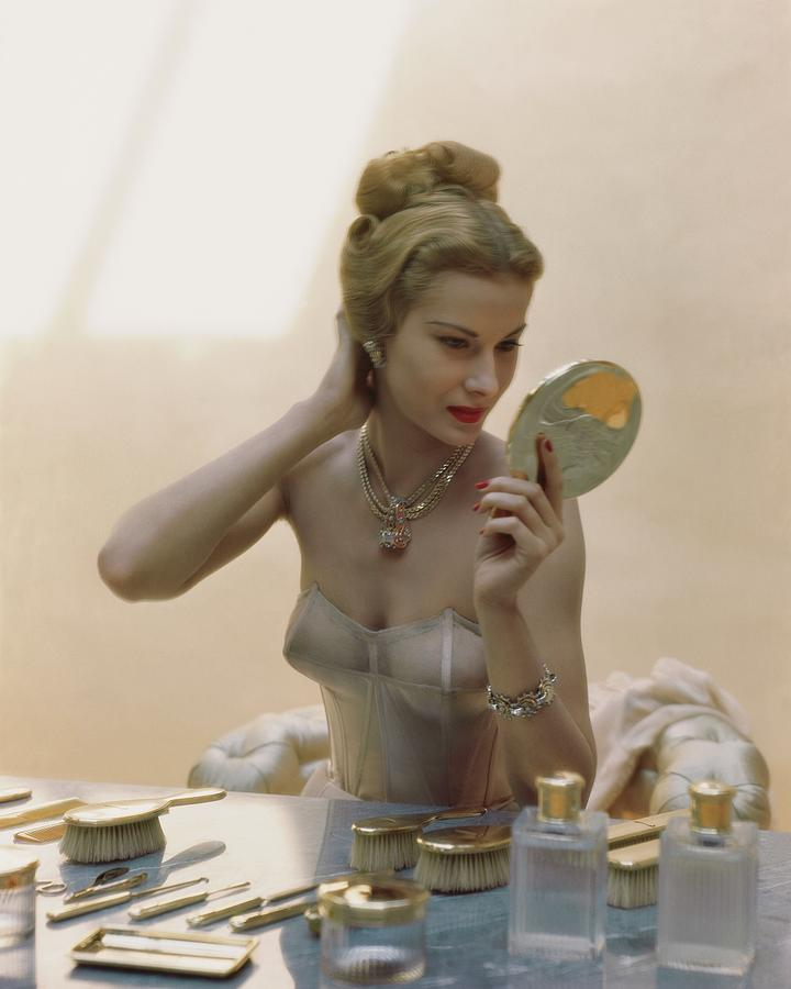 A Model At A Dressing Table Photograph by John Rawlings