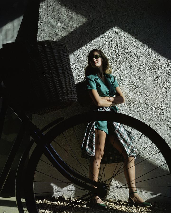 A Model Behind A Bicycle Photograph by John Rawlings