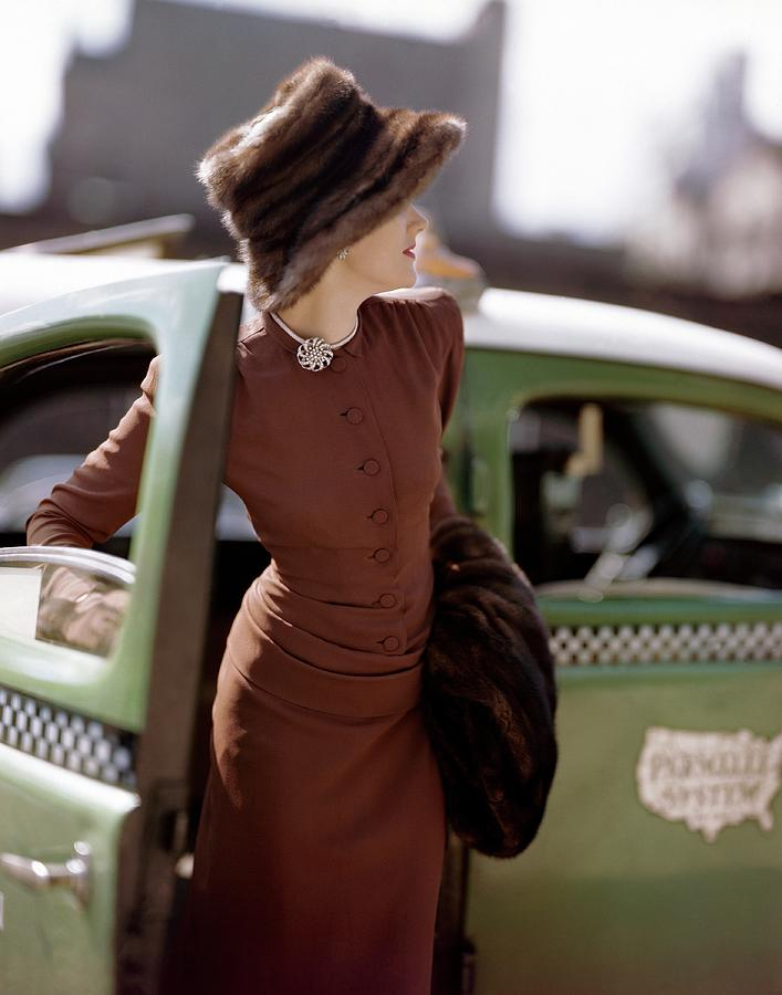A Model Getting Out Of A Cab Photograph by Constantin Joffe