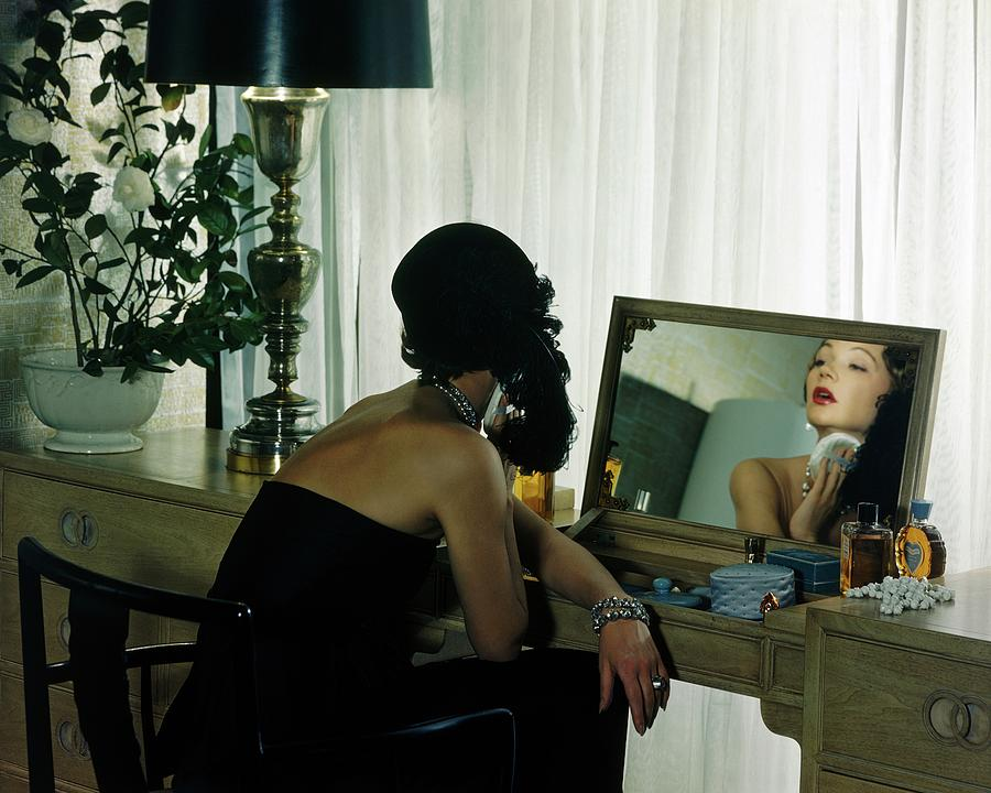 A Model Getting Ready In A Mirror Photograph by Herbert Matter