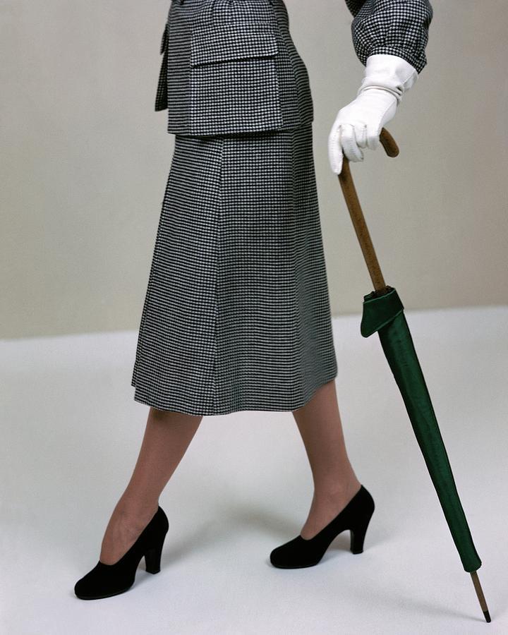 A Model Holding An Umbrella Photograph by Serge Balkin