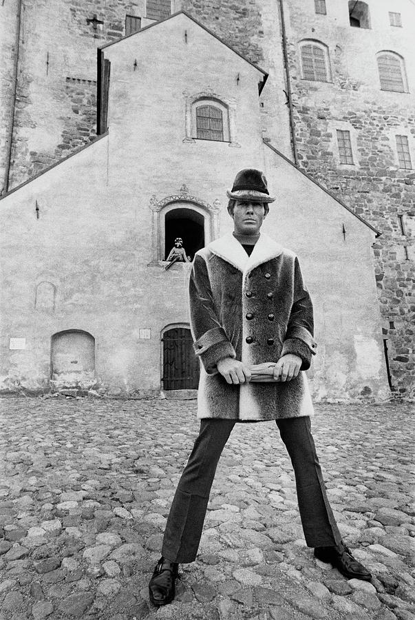 A Model In A Double-breasted Coat With Eight Photograph by Leonard Nones