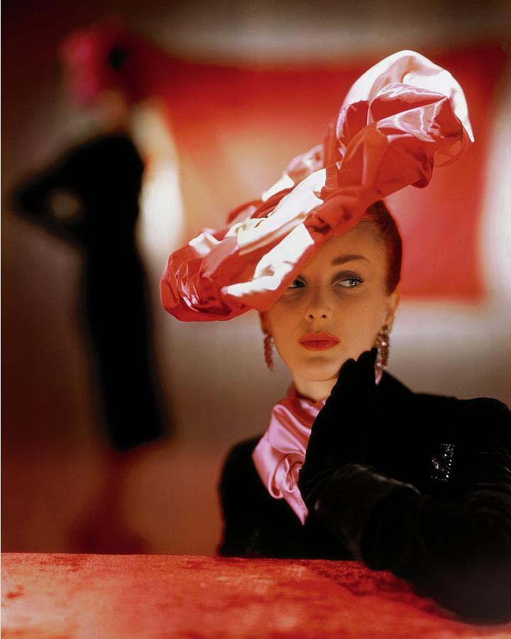 A Model In A Suzanne Et Roger Hat Photograph by John Rawlings