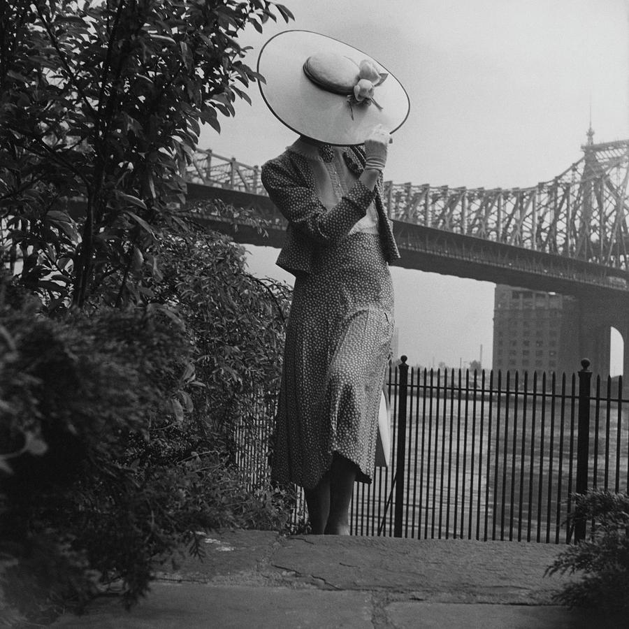A Model In Front Of The 59th Street Bridge Photograph by Horst P Horst