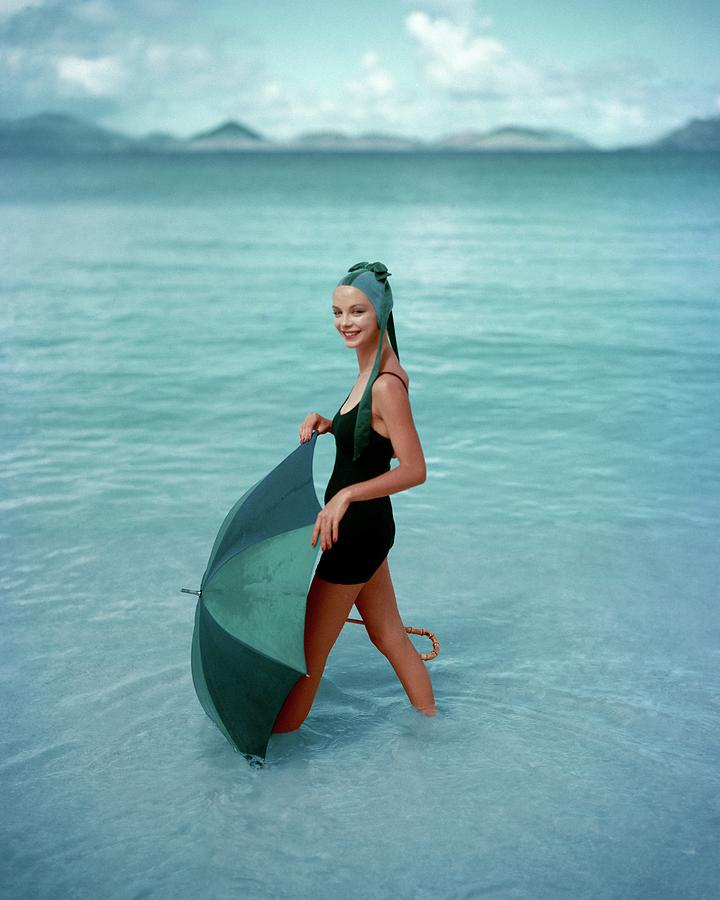 A Model In The Sea With An Umbrella Photograph by Richard Rutledge