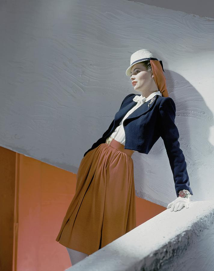 A Model Leaning On A Wall Photograph by Horst P. Horst