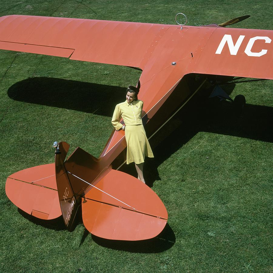 A Model Leaning On An Airplane Photograph by Toni Frissell